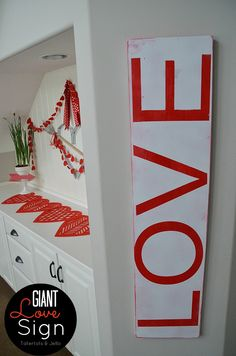 This Giant Love Sign from TatertotsandJello.com is perfect for Valentine's Day! #diy #decor
