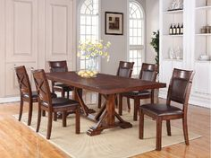 Woodsman Table and 6 Side Chairs combines the rich look of walnut, hickory and mango veneer. Table is 44