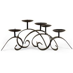 @Overstock - This Old Spanish Mission centerpiece candle holder is an elegant swirling masterpiece. Handcrafted of wrought iron, this candle holder will provide your home with a graceful aesthetic.http://www.overstock.com/Home-Garden/Old-Spanish-Mission-Centerpiece-Candle-Holder/5179269/product.html?CID=214117 $69.99