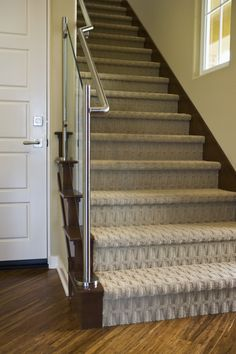 Carpet on stairs can be just as modern and elegant as hardwood. These stairs feature a contemporary patterned carpet and recessed lighting! Wall Carpet, Grey Carpet, Bedroom Carpet, Modern Carpet, Living Room Carpet, Carpet Flooring, Rugs On Carpet, Carpets, Shaw Carpet