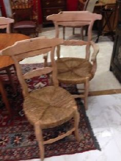 Country French Dining Chairs, just like being on Provence! Beautiful lines, distressed, bleached hard wood, rush seats. 2 armchairs (23 x 20 x 39 in. tall) 4 side chairs (17 x 18 x 36).