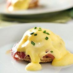 Mini Eggs Benedict -- Natures Pride bread with prosciutto, coffee sauce, quail eggs, and Hollandaise. Brunch in a bite!