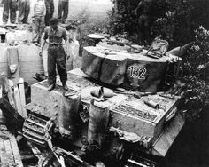 Engineer crews are trying to figure out how to recover  Tiger 1 nr. 132 that has become trapped after of a bridge collapse