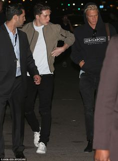 On the move: Brooklyn Beckham preferred to spend Wednesday night away from his clan as he ...
