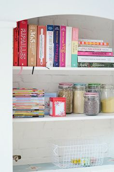 A nice way to display cookbooks on open shelving in the kitchen