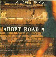 The Beatles' Abbey Road Photo Shoot Outtakes The Beatles' iconic (and widely imitated) album cover Abbey Road shows all four band members walking across London's Abbey Road. At that time The Beatles were recording the majority of their songs and albums at Abbey Road Studios (was then called EMI Studios). On August 8, 1969.