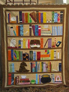 The Project of Doom - Completed Quilt Top    A Harry Potter Bookcase Quilt, conceived of, designed and presented as a Block of the Week by Jennifer Ofenstein for Harry Potter Paper Piecing.