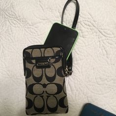 COACH phone wristlet Authentic coach wristlet! It is a PERFECT place to carry your phone and some cards. It's a great wristlet. Coach Bags Clutches & Wristlets