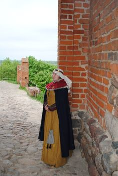 Outfit from turn of 14th and 15th century.Chemise, hose, garters, shoes, cotte simple, over kirtle with attached sleeves, cloak, veil and hood are all based on extant clothing and iconography and are completely hand-sewn
