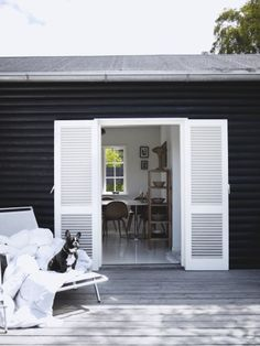 Black house, white shutters (and throw in a b & w dog for effect!) From Scandinavian Retreat Black Exterior, Interior And Exterior, White Shutters, Louvered Shutters, White Doors, Decoration Inspiration, Design Blog, Decorating Blogs, House Painting