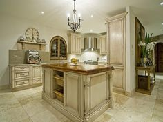 French provincial kitchen. This would look better with black hardwood floors.