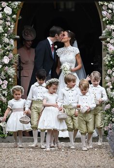 Kate Middleton Photos Photos - Pippa Middleton (centre R) kisses her new husband James Matthews, following their wedding ceremony at St Mark's Church in Englefield, west of London, on May 20, 2017, as the bridesmaids, including Britain's princess Charlotte (L) and pageboys, including Britain's prince George (2R), walk ahead..After turning heads at her sister Kate's wedding to Prince William, Pippa Middleton graduated from bridesmaid to bride on Saturday at a star-studded wedding in an…