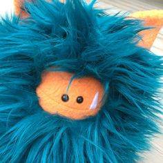 Striking teal faux fur with cute orange face and ears... this Fuzzling is ready for adoption! Visit me online for details!