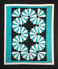 """Dynamic Dresden Quilt By Laird, Cathey  - 66in x 78in. Uses Creative Grids CGR18CF. Project Type: 6 Hour+.Fabric Type: Yardage Friendly.Project Type: Quilt. CLP patterns are printed on 8-1/2"""" x 11"""", anti-copy card stock. Because they are customized with your shop's Bill-to account name, phone number and web site, they are not returnable."""