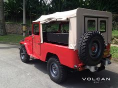 Roll up those sides! 'Rosalina' is our vintage 1981 Land Cruiser FJ43 in freeborn red & tan soft top from Volcan 4x4.
