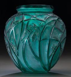 R. Lalique Green Glass Sauterelles Vase. Circa 1912. Wheel carved R. LALIQUE; Engraved FRANCE