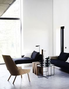 BdV HIS office , lounge area masculine simplistic wood white walls grey flooring clean lines