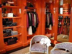 I think this is a Tory Burch store - love the orange lacquered walls #storage #closet
