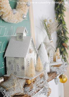 DIY Home Decor for Christmas. Glitter houses and bottle brush trees create a festive mantel.