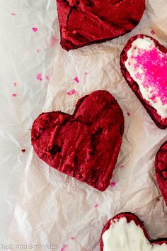 Red Velvet Hearts are the perfect sweet to bake this Valentine's Day! Thick, fudgy and super festive. And don't forget the cream cheese frosting. You'll love this #easy recipe. #redvelvet #valentinesdaydesserts #valentinesdayrecipes #creamcheesefrosting
