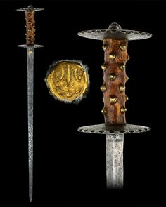 "Wonderfully preserved rondel dagger, circa 1450. A blade of triangular section inlaid with a gilt mark. Overall length: 60.8 cm (23.94""); Blade length: 48.3 cm (19""). [768 x 960]  Located at Reichsstadtmuseum Rothenburg, Germany"