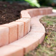 curvy brick border install vertical inner double layer close up # Brick Garden Edging, Lawn Edging, Garden Borders, Shaded Garden, Flowers Garden, Garden Plants, Brick Planter, Wooden Garden Planters, Flower Bed Borders
