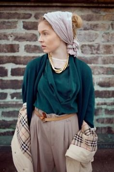 English green, beige, drapé, checks, a perfect golden necklace and a headscarf.