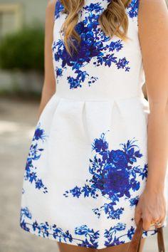 Blue on white floral dress.