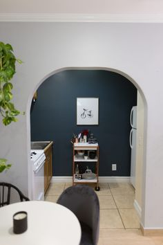 Painting a statement navy blue wall in a small kitchen gives the space depth and drama!