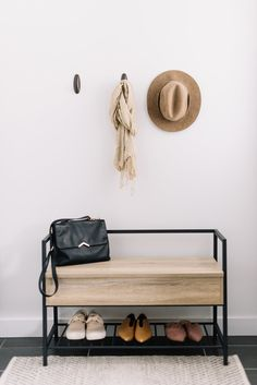 a small modern bench with black metal framing and a large seat with hidden stora… – 2019 - Entryway Diy Furniture, Interior, Industrial Design Furniture, Home Decor, House Interior, Apartment Decor, Modern Storage Bench, Storage Bench Designs, Furniture Design