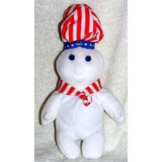 2008 Patriotic Red White and Blue Pillsbury Doughboy 9 Plush Giggling Bean Bag Doll with Sound  Plush Patriotic Red White and Blue Pillsbury Doughboy Bean Bag Doll with sound. He is wearing a red and white striped hat with a blue band with stars on it and a red and white striped neck tie. Press his belly and he makes a laughing or a giggling sound. Approx. 9 high from top of hat to bottom of feet. Made in 2008.