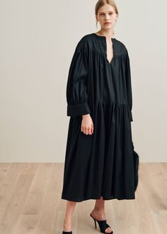 Oversized dress cut from a sheer cotton voile fabric. It has a v-neck, wide cuffs, gathered skirt, and wide silhouette. Modest Fashion, Fashion Outfits, Kimono Design, Oversized Dress, Summer Dress Outfits, Dress Cuts, Tiered Dress, Elegant Outfit, White Fashion