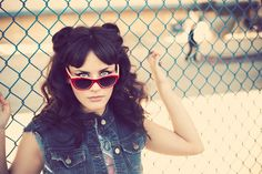 Dig it: the hair, the makeup, the vintage sunglasses. But the jean vest, not so much. <--- Ditto.