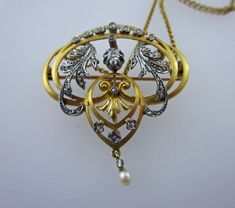 I have here the most exsquisite French Art Nouveau Brooch Pendant which is set with diamonds. The pendant has a freshwater pearl drop which adds to the decoration of this beautiful pendant. The chain is attatched with two catches to the pendant to be taken off when wearing as a brooch. In the