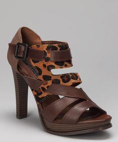 Take a look at this Brown Leopard Haircalf Tamia Shoe by Calvin Klein on #zulily today! $39.99, regular 109.00.  PRODUCT DESCRIPTION: A riot of rich crisscrossed leather straps with opulent Haircalf detail atop a sky-high heel makes this sassy, gam-amping sandal a wow-worthy must-have.   4.5'' heel with 0.75'' platform Buckle closure Leather / Haircalf upper Man-made sole Imported