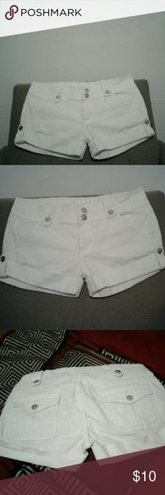 All white short. These shorts are all white with silver buttons. They have been worned a few times but dont look it. Salong them for a great affordable price. I no longer can fit them do to weight loss. dbl Shorts Jean Shorts