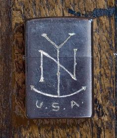 Hand-engraved lighter by Jon Contino.