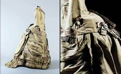Sage green-grey taffeta day dress, English, ca. 1876. The jacket bodice with faux satin waistcoat panels, satin bows to cuffs, and to fringed hemline of skirt. Sotheby's