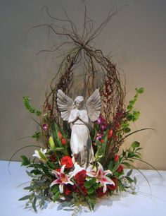 Sympathy Bouquet, love the sheltering with the curly willow.