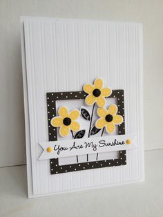 handmade card ... clean and simple ... yellow punched flowers on top of a black polka dot frame ... luv the sharp look of yellow and black ...
