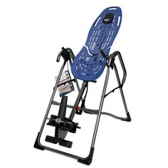 Stretch your muscles with this folding Teeter Hang Ups EP-960 inversion table. With its triple-lock security system, the table supports up to 300 pounds. The adjustable supports ensure comfort, and the 60-degree rotation allows stretches and exercises.