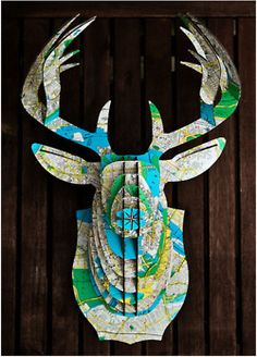 stag head made out of paper maps #onekingslane #designisneverdone