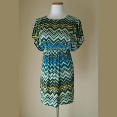 Adorable Chevron Print Dress Adorable Chevron Print Dress with open back and button closure. Split dolman sleeves, lined top. Jr's Small.   No Trade or PP.  Offers Considered.  Bundle discounts. Sweet Storm  Dresses