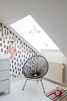 chair + tree wallpaper + skylight and black and white