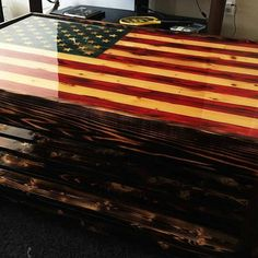 """x x 20 """" tall Wood Inlay American Flag Coffee Table with epoxy top (looks like glass) finish. The wood has a torched /distressed/ polyurethane finish with a bottom shelf. Also available lifting top concealment area. Happy Vet, American Flag Wood, Lift Top Coffee Table, Coffee Tables, Model Train Layouts, Old Glory, How To Distress Wood, Model Trains, Light In The Dark"""