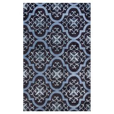 Anchor your living room seating group or define space in the den with this hand-woven rug, showcasing a trellis motif and blue hue. joss& main