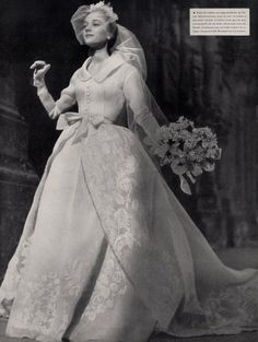 1953 Jacques Fath wedding dress: a French fashion designer who was considered one of the three dominant influences on postwar haute couture, the others being Christian Dior and Pierre Balmain She looks so happy! Wedding Dress Styles, Wedding Attire, Bridal Dresses, Wedding Gowns, Modest Wedding, Prom Gowns, Homecoming Dresses, Wedding Bride, Jacques Fath