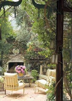 The most important part of any outdoor living room is the garden. This feels like a cozy English garden, ideal for morning tea.