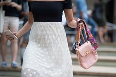 Best Street Style Shoes and Bags from Fashion Week Spring 2015 - New York Fashion Week - A camera with a quirky strap looks so much more chic fronted by a powder-pink Chanel handbag.