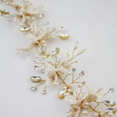 Handmade bridal accessories. This bridal headpiece has stunning handmade flowers.